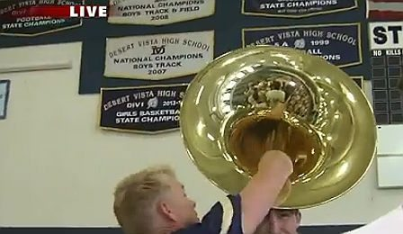 While reporting on a high school marching band segment, enthusiastic Fox 10 reporter Cory McCloskey accidentally drops his microphone down the horn a sousaphone - live on air.